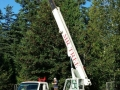 Using a commercial lifting crane for a local tree service in Portland